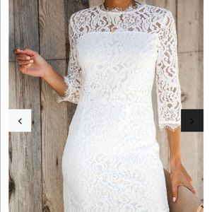 Embark in style white lace Vici dress
